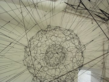 Galaxies forming along filaments, like droplets along the strands of a spider's web' 2009 by Tomas Saraceno